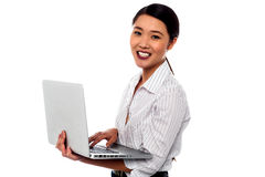 Girl with laptop over white background Stock Photography