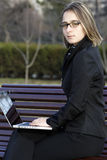 Girl with laptop in the park Stock Image