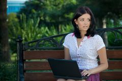 Girl with laptop in park Stock Image
