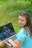 A girl with a laptop in the park. Royalty Free Stock Photography