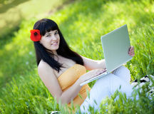 Girl with laptop in the park Royalty Free Stock Image