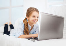 Girl with laptop pc at home Stock Photo
