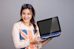 Girl with laptop for present Royalty Free Stock Photos