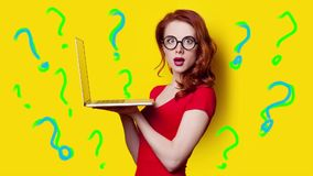 Girl with laptop and question marks. Gif animated video of beautiful young woman holding laptop and question marks around on the wonderful yellow studio stock video