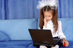 Girl with laptop and red apple Stock Photography