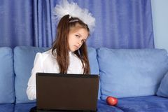 Girl with laptop and red apple Stock Photos