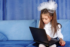 Girl with laptop and red apple Royalty Free Stock Photo