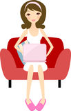 Girl with laptop relaxing at home Stock Images