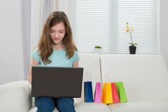 Girl With Laptop And Shopping Bags Royalty Free Stock Images