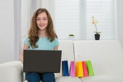 Girl With Laptop And Shopping Bags Stock Photo