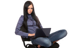 Girl with the laptop sits on a chair Stock Photos