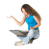 Girl with laptop sits on floor Stock Photo