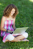 Girl With Laptop Sitting On Grass Stock Photo