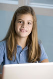 Girl with laptop. Girl studying with laptop at school Royalty Free Stock Image
