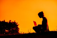 Girl with laptop on sunset Royalty Free Stock Images