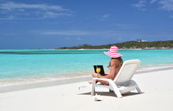 Girl with a laptop on the tropical beach Stock Photo