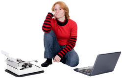 Girl with the laptop and a typewriter Stock Photos
