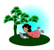 Girl with laptop under a tree Royalty Free Stock Photo