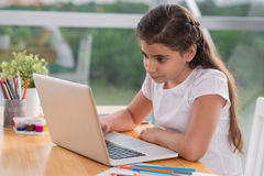 Girl with a laptop Stock Images