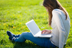 Girl with laptop. Girl works on laptop outdoors stock photo
