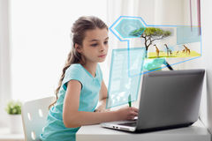 Girl with laptop writing to notebook at home. People, education and technology concept - girl with laptop computer writing to notebook at home over wild animals royalty free stock images