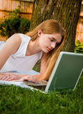 Girl on Laptop in Yard Stock Photography