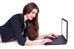 Girl with laptop. Young girl with laptop sufing on the internet Royalty Free Stock Photos