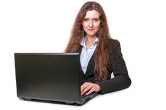 Girl with laptop. Young girl with laptop sufing on the internet stock images