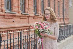 Girl with a big bouquet of tulips Royalty Free Stock Image