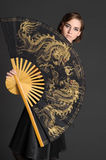 Girl with large Chinese fan Royalty Free Stock Photography