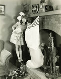 Girl with large Christmas stocking Royalty Free Stock Photos