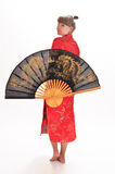 Girl  with a large oriental fan Stock Photography