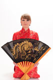 Girl  with a large oriental fan Royalty Free Stock Image
