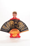 Girl  with a large oriental fan Stock Photos