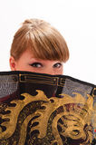 Girl  with a large oriental fan Royalty Free Stock Photography