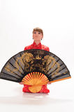 Girl  with a large oriental fan Stock Photo