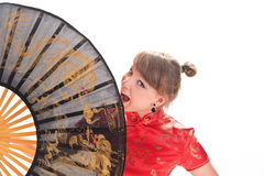 Girl  with a large oriental fan Royalty Free Stock Photos
