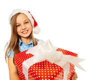 Girl with large present in Santa hat smile Stock Photos