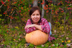 Girl with large pumpkin Stock Images