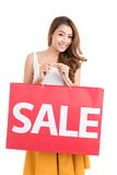 Girl with large sale bag Royalty Free Stock Photo