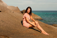 Girl is on the large stone on the beach, Similan Islands, Thailand Stock Images