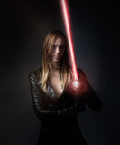 Girl with laser sword Stock Photo