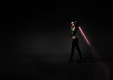 Girl with laser sword Royalty Free Stock Image