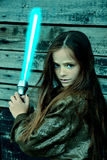 Girl with laser sword. Teenage girl fighting with laser sword stock images