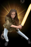 Girl with laser sword. Teenage girl fighting with laser sword royalty free stock photos