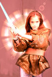 Girl with laser sword. Teenage girl fighting with laser sword Royalty Free Stock Photography