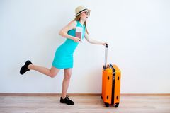 Girl late for a plane. Girl is late for her plane running with her suitcase stock image