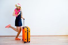 Girl late for a plane. Girl is late for her plane running with her suitcase royalty free stock images