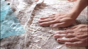 Girl lathers procurement of wool during felting. Close up stock footage