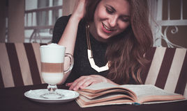 Girl with latte Stock Image
